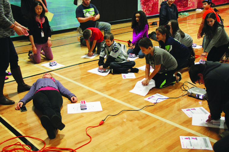 Kids learning compression CPR. Photo/Micheal Rios, Tulalip News