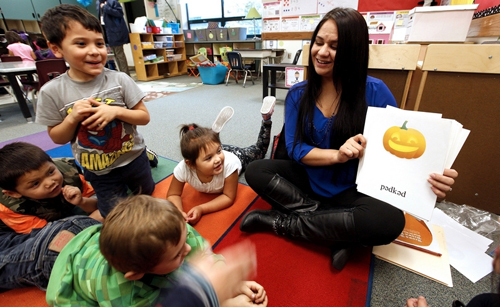 Andy Bronson / The HeraldWith the help of flash cards, kindergartners at Quil Ceda Tulalip Elementary School speak the Lushootseed language with instructor Nik-Ko-Te St. Onge. From left: Jaycee Williams, Jesse Lozano,Tyler Hills and Joscelynn Jones-Lloyd.