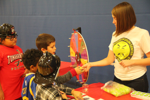 Washington Poison Center representatives taught kids about about poisonings and toxic substances using a wheel spinning game. Photo/Micheal Rios