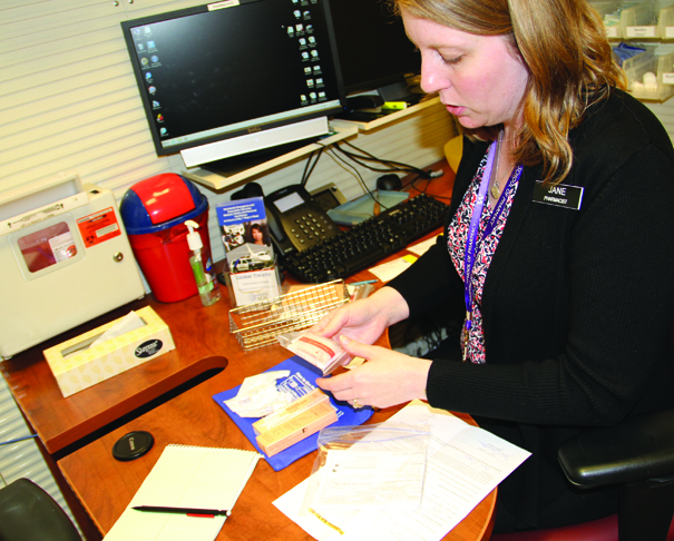 Tulalip Pharmacist Jane Jacobson describes the contents and uses of a Narcan kit, which are available at the Tulalip Pharmacy. Photo/Niki Cleary, Tulalip News