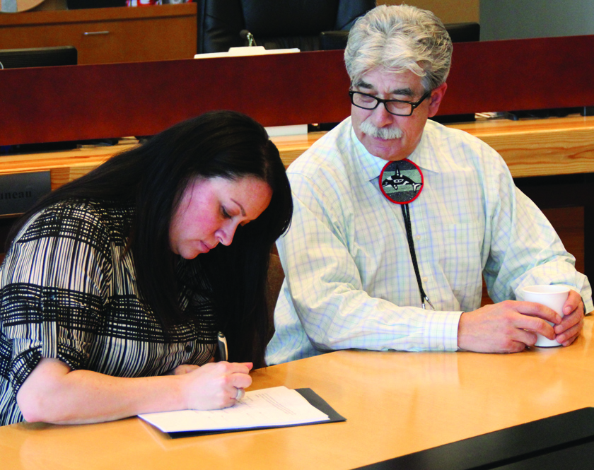 Misty Napeahi, Tulalip Tribes General Manager and Mel Sheldon, Tulalip Tribes Chairman, signing the government-to-government child welfare agreement between the Tulalip Tribes and the State of Washington.Photo/Micheal Rios