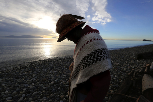 "Lummi hereditary chief Bill James, on the beach at Cherry Point, says saving it is to preserve ""the tribe's very way of life."" It's the site of an ancient Lummi village. (Alan Berner/The Seattle Times)"